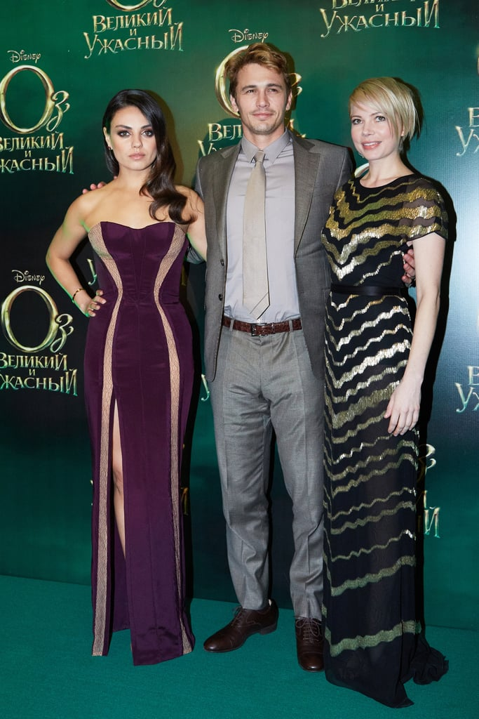 At the Moscow premiere of Oz the Great and Powerful, Mila Kunis chose a plum strapless Atelier Versace gown, while Michelle Williams shimmered in a black-and-gold printed Jason Wu dress.
