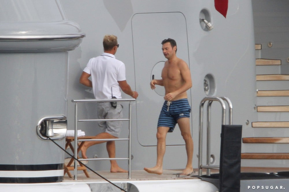 Ryan Seacrest went shirtless for a dip in the sea.