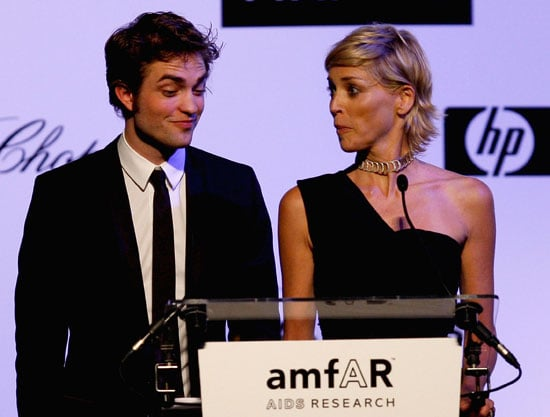 Photo of Robert Pattinson and Sharon Stone at amfAR Gala in Cannes