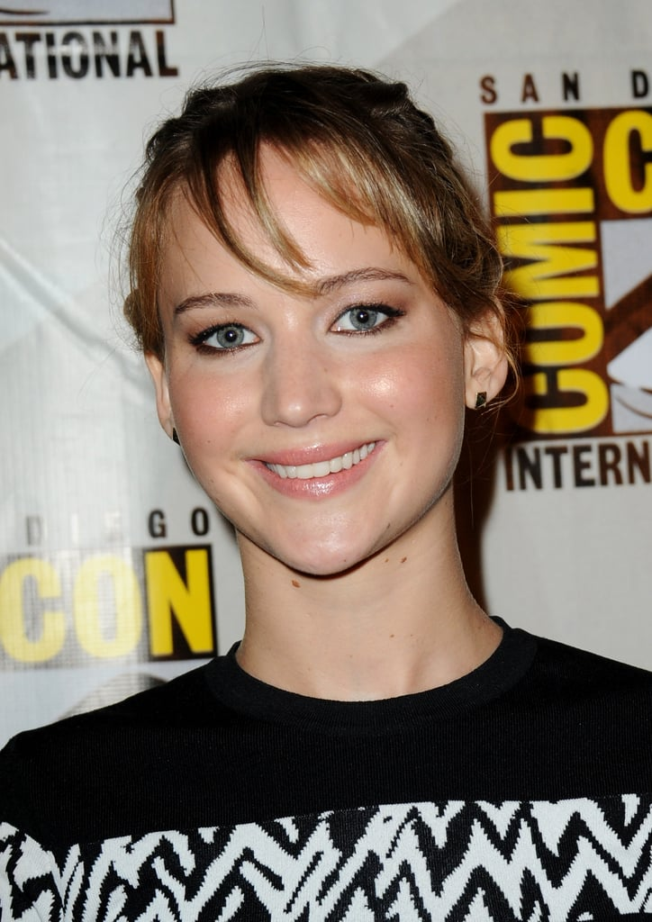 Always the golden girl, Jennifer Lawrence opted for a dewy complexion, piecey bangs, and thick eyeliner.