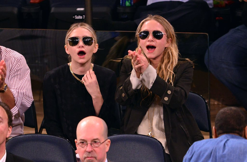 Ashley and Mary-Kate Olsen sported shades and smiles during a NY Knicks game in May 2013.