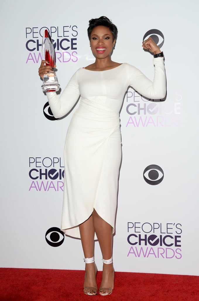 Jennifer Hudson flexed her muscles in the press room after picking up the favorite humanitarian award.