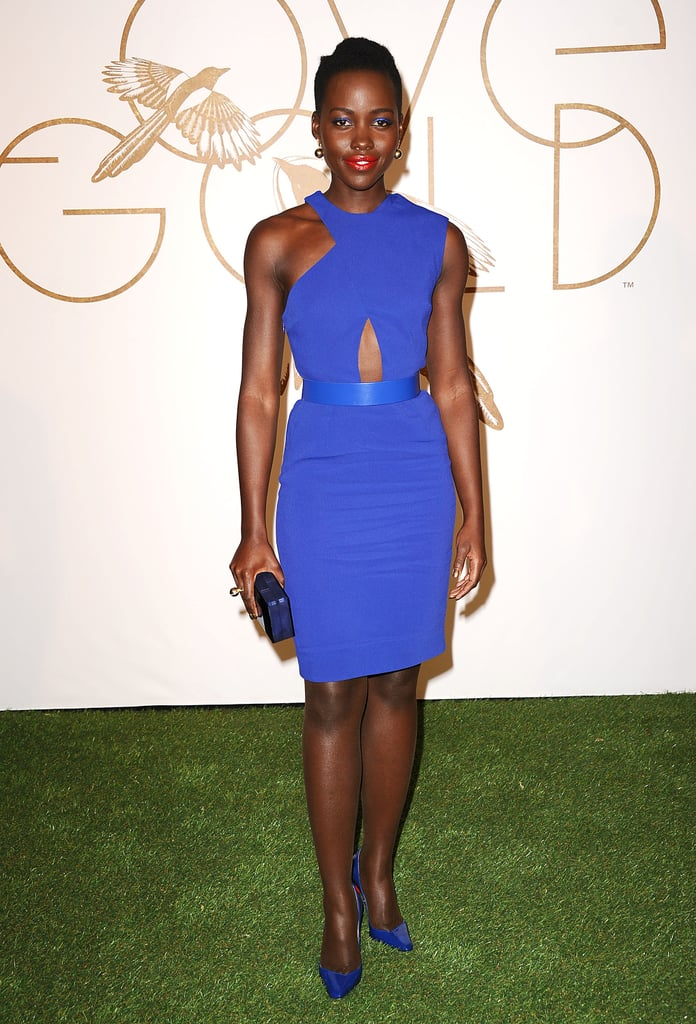 Lupita wore Elena Votsi gold and diamond earrings and a gold ring to the bash.