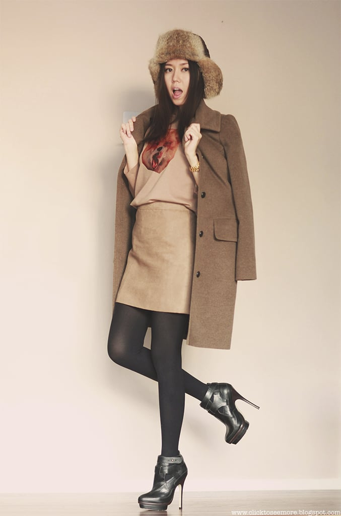 Give sophisticated separates a cold-weather twist with tights and a fur trapper. Source: Lookbook.nu
