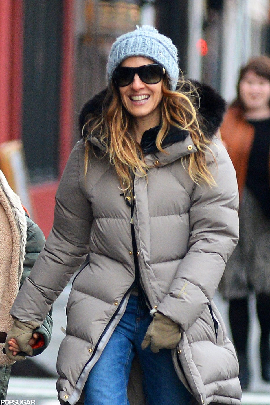 Sarah Jessica Parker wore a puffy jacket and a blue hat.