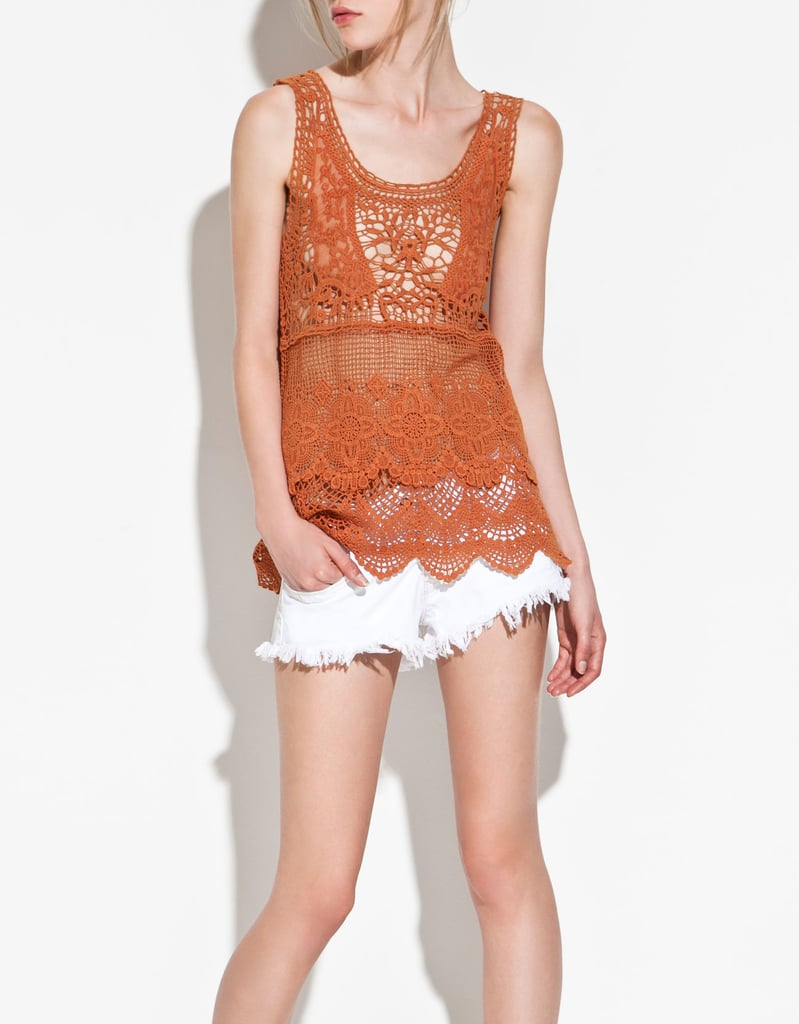 We love the idea of pairing this burnt orange crochet top with a white eyelet skirt and oversized belt.  Zara Crochet Top ($40)