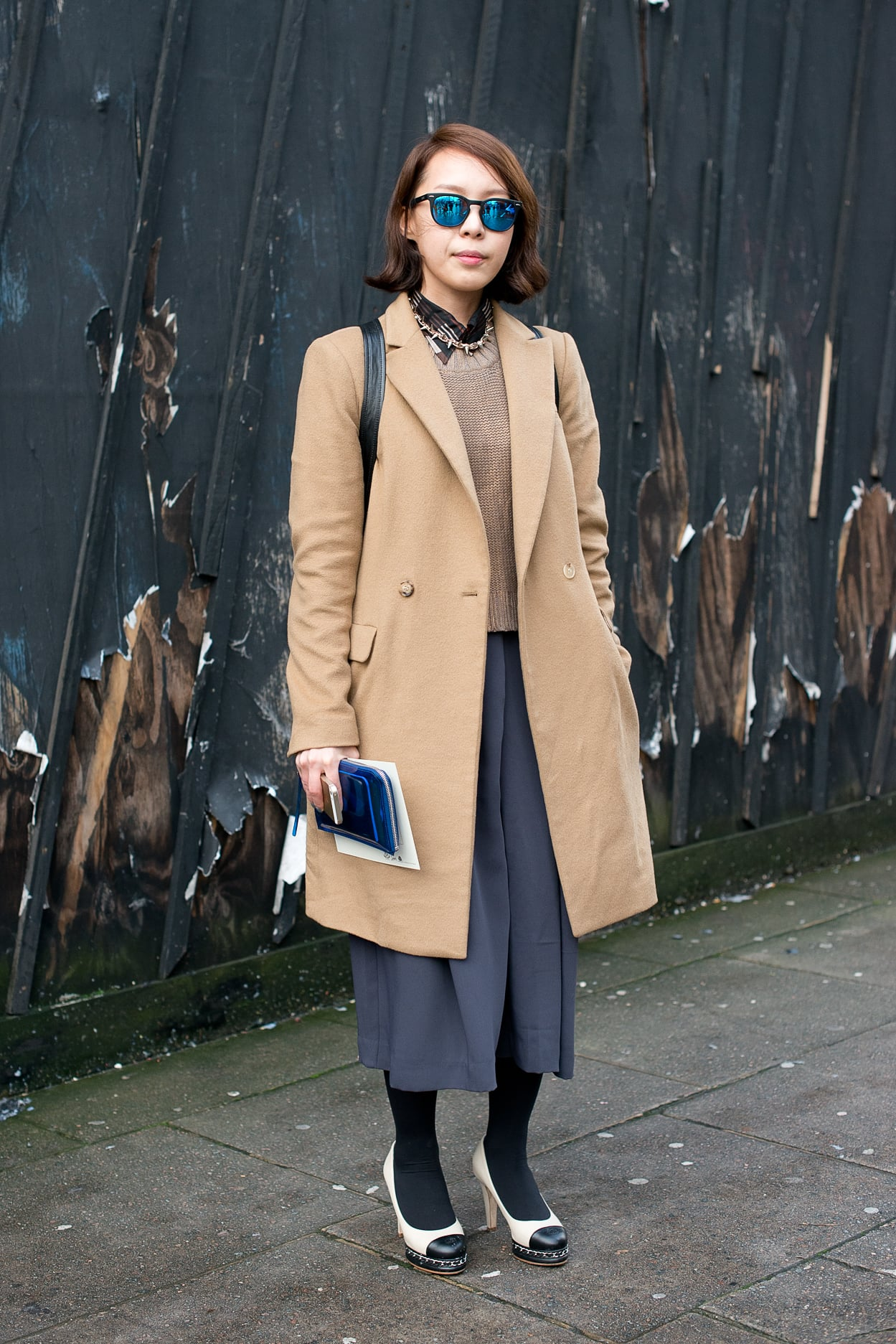 Who knew how well a classic camel coat paired with brilliant, mirrored shades?