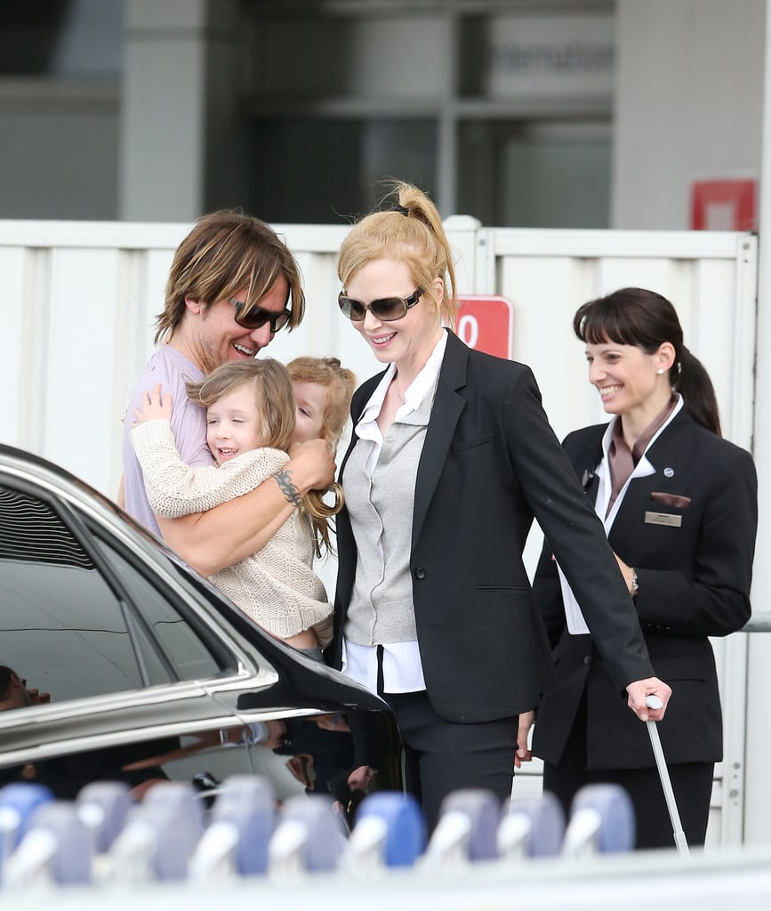 Keith Urban got big hugs from his daughters, Sunday Rose and Faith Margaret.