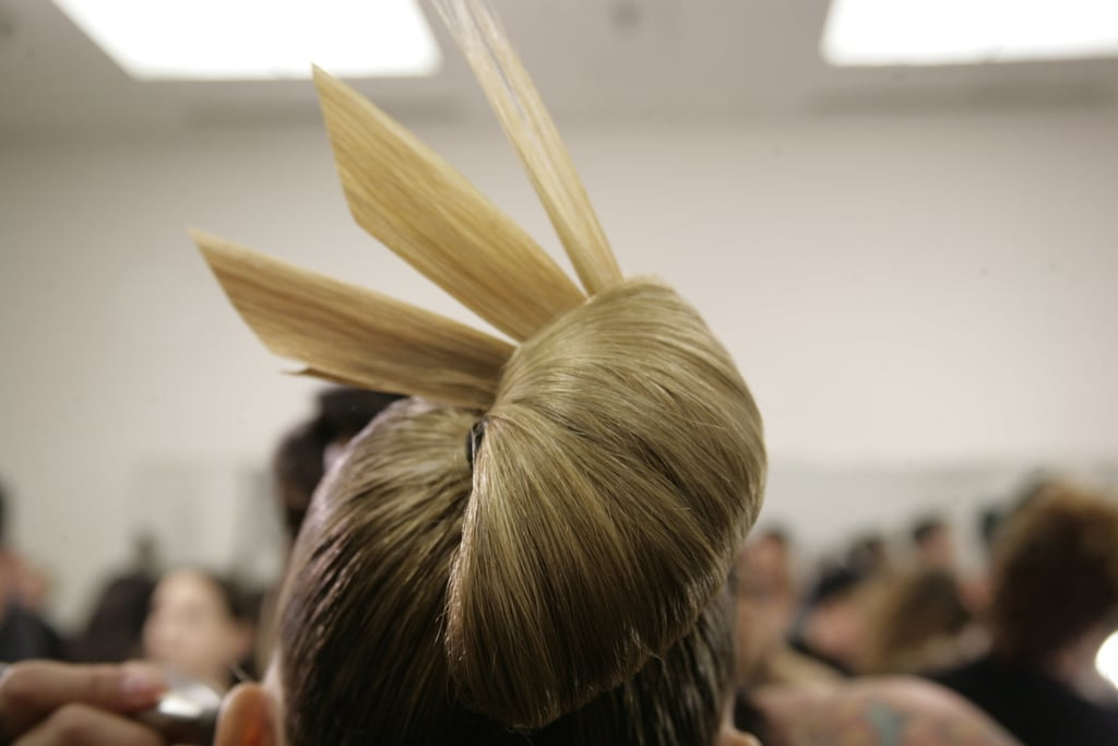 Hair was then rolled under to form a bun and stiffly gelled extensions were added for the high-fashion, architectural effect.  Photo: Megan Holmes