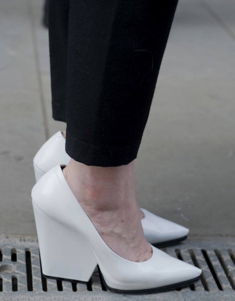 White pointy-toe pumps popped against black cropped trousers.