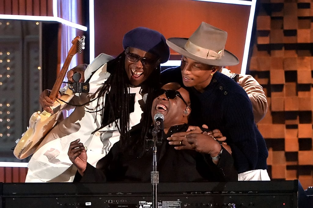 Pharrell Williams and Nile Rodgers hugged Stevie Wonder during their performance.