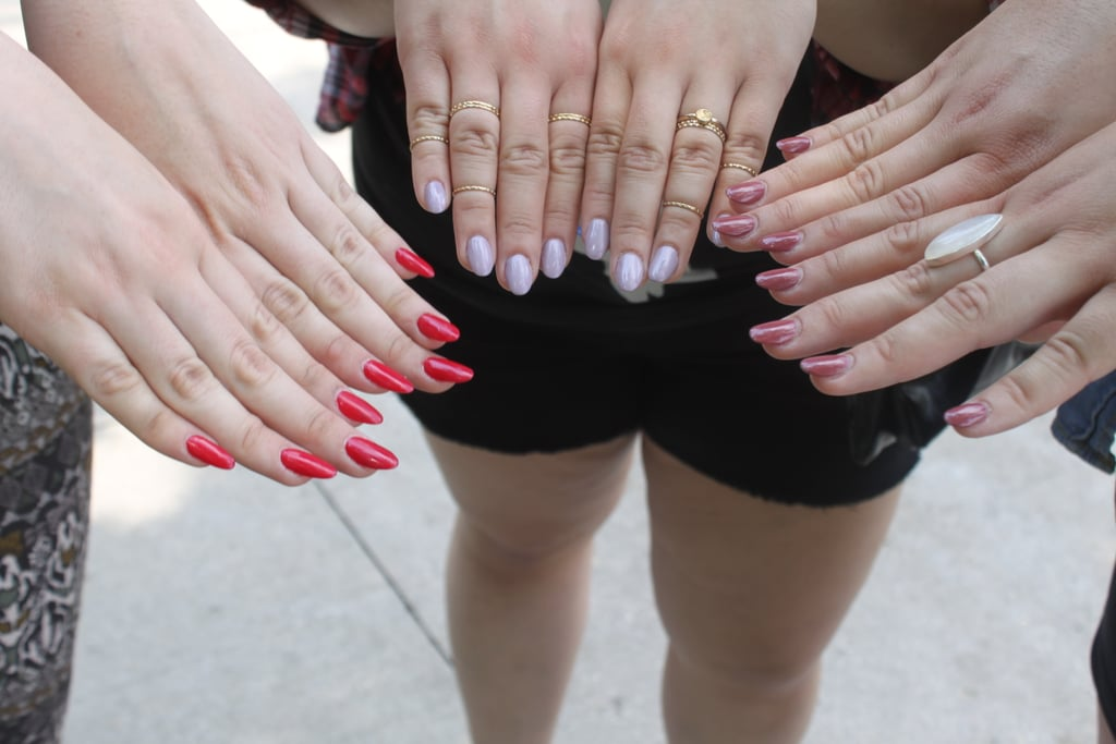 Even an outdoor music festival calls for a fresh manicure. Isabel went with a classic red shade, while her friends opted for more muted hues.