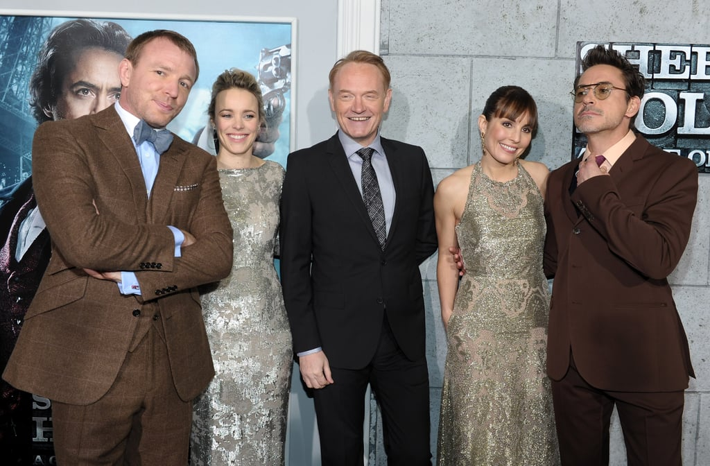 Guy Ritchie posed with his actors, Rachel McAdams, Jared Harris, Noomi Rapace, and Robert Downey Jr.
