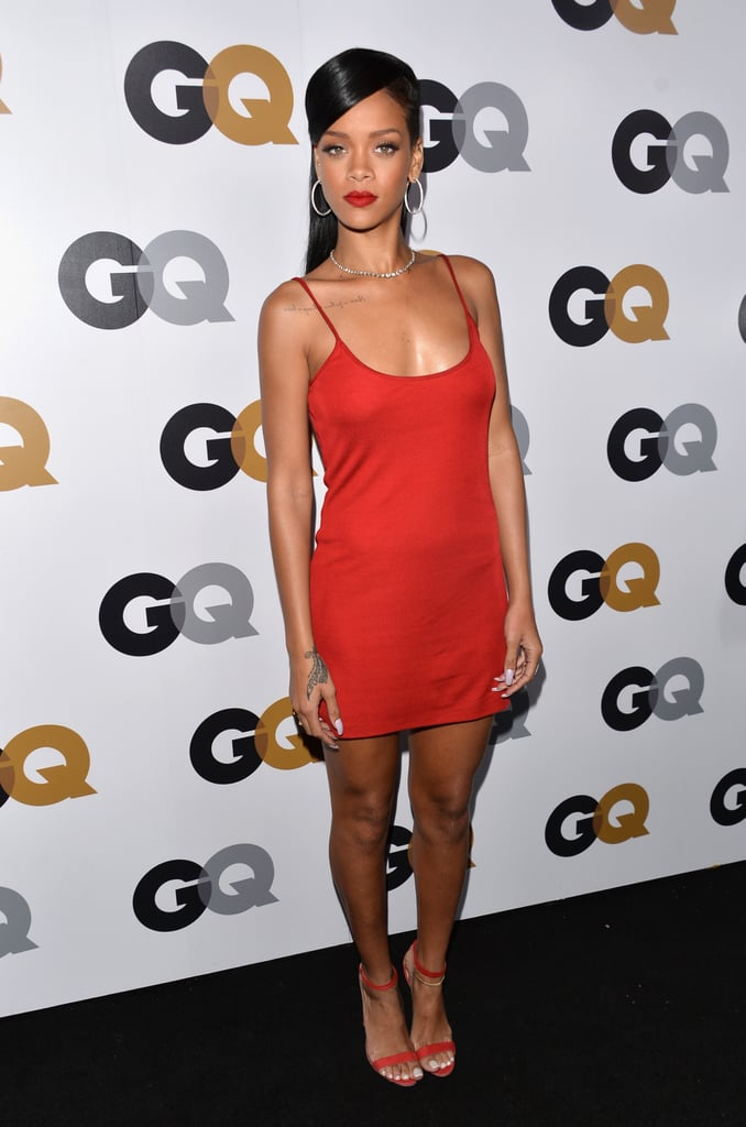 Rihanna showed off her curves in a simple yet sexy strappy red dress by Calvin Klein, paired with Manolo Blahnik sandals, hoop earrings, and a bold red lip.