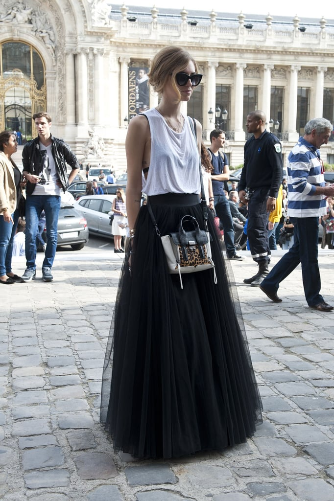 Chiara Ferragni did casual up top, princess-worthy on the bottom with a touch of leopard print on her 3.1 Phillip Lim bag.