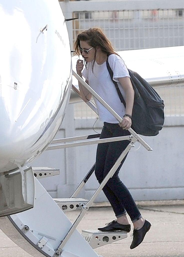 Kristen Stewart wore white sunglasses.