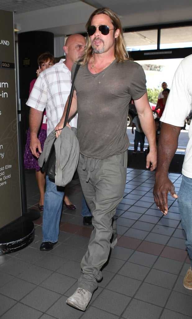 Brad Pitt showed off his pecs in a tight t-shirt at LAX.