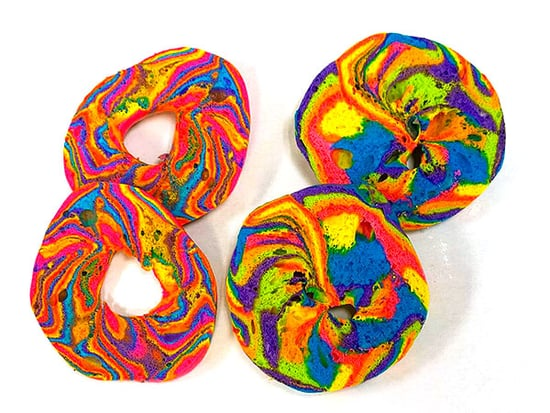 These Crazy Rainbow Bagels Are Stuffed with Cotton Candy and Funfetti Cream Cheese, Naturally