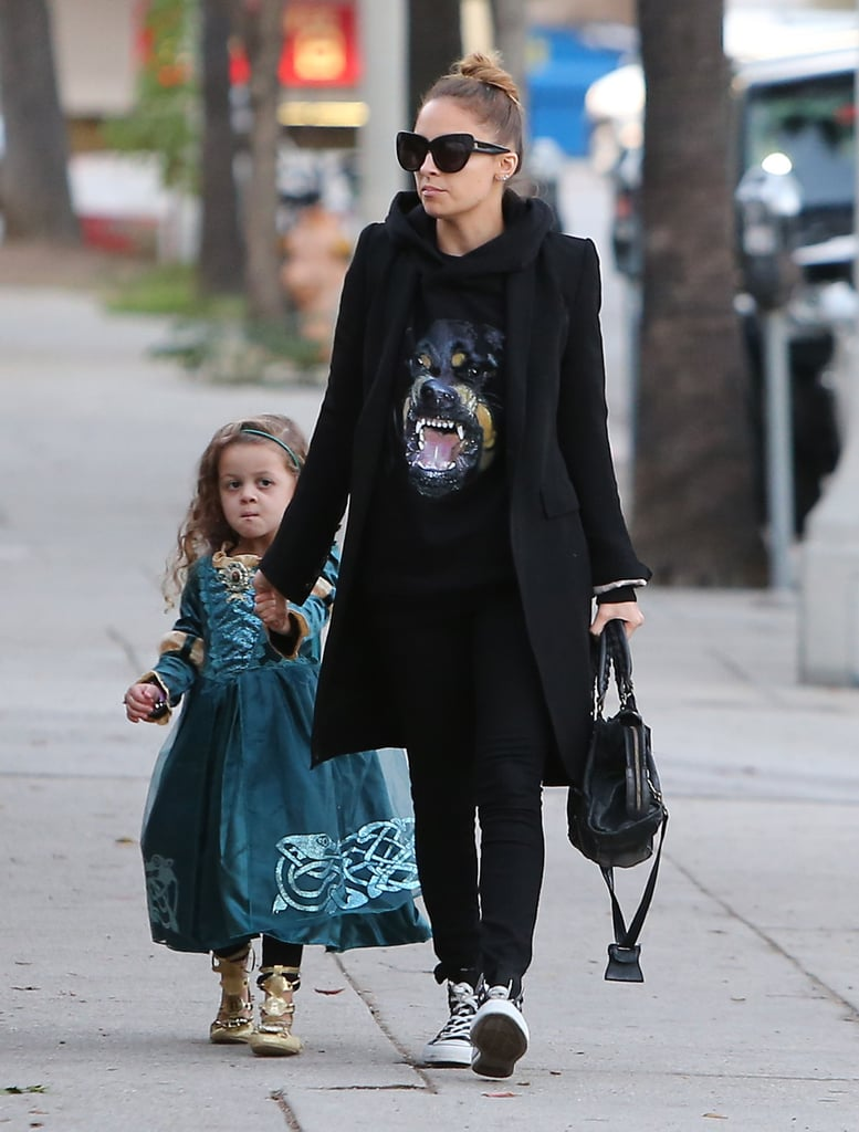 Nicole Richie held hands with Harlow Madden.