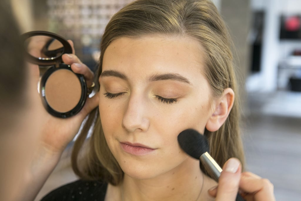 """Once your foundation is blended (even on the neck), grab your favorite bronzer — Bettelli likes Pro Longwear Bronzer ($30) — and use a fluffy powder brush to apply it along your hairline, cheekbones, neck, and jaw. """"I like to sweep the bronzer across the face in a W shape to subtly contour the nose and cheeks."""""""