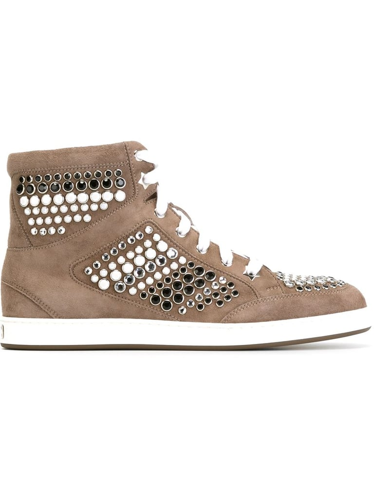 """We're betting these glimmering Jimmy Choo """"Tokyo"""" high-top sneakers ($650) could even turn heel addicts into sneaker converts in no time."""