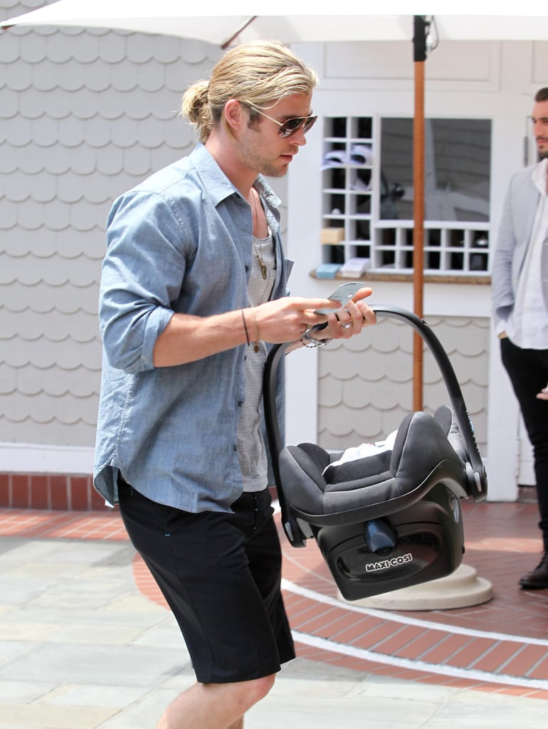 Chris Hemsworth carried a car seat.