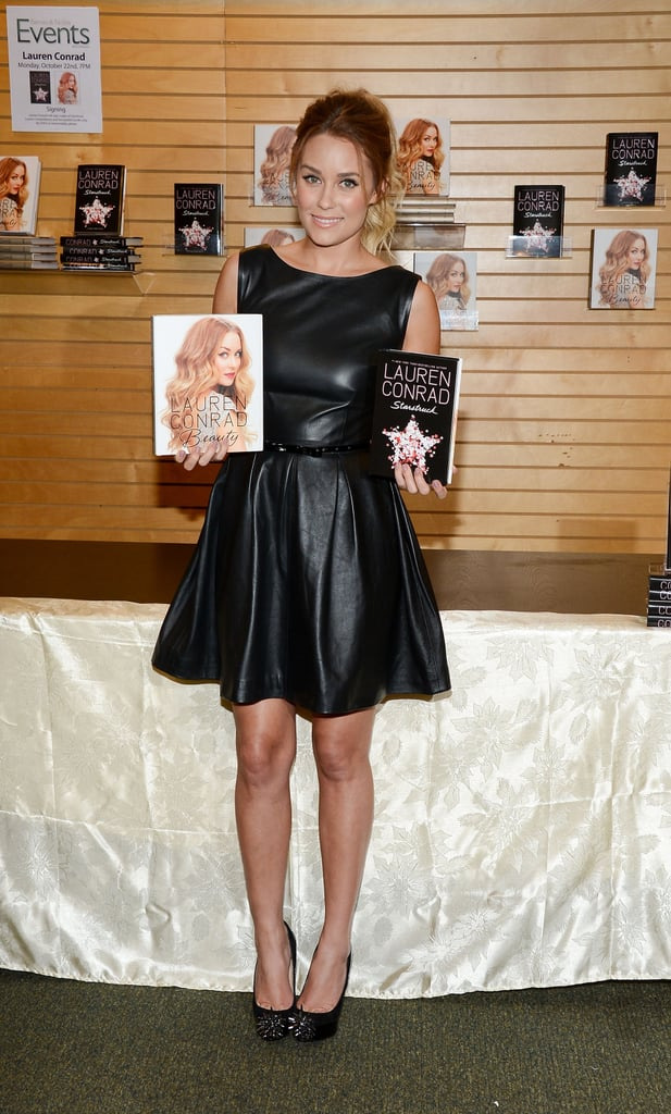 Lauren Conrad wore a black leather dress to her book signing in LA.