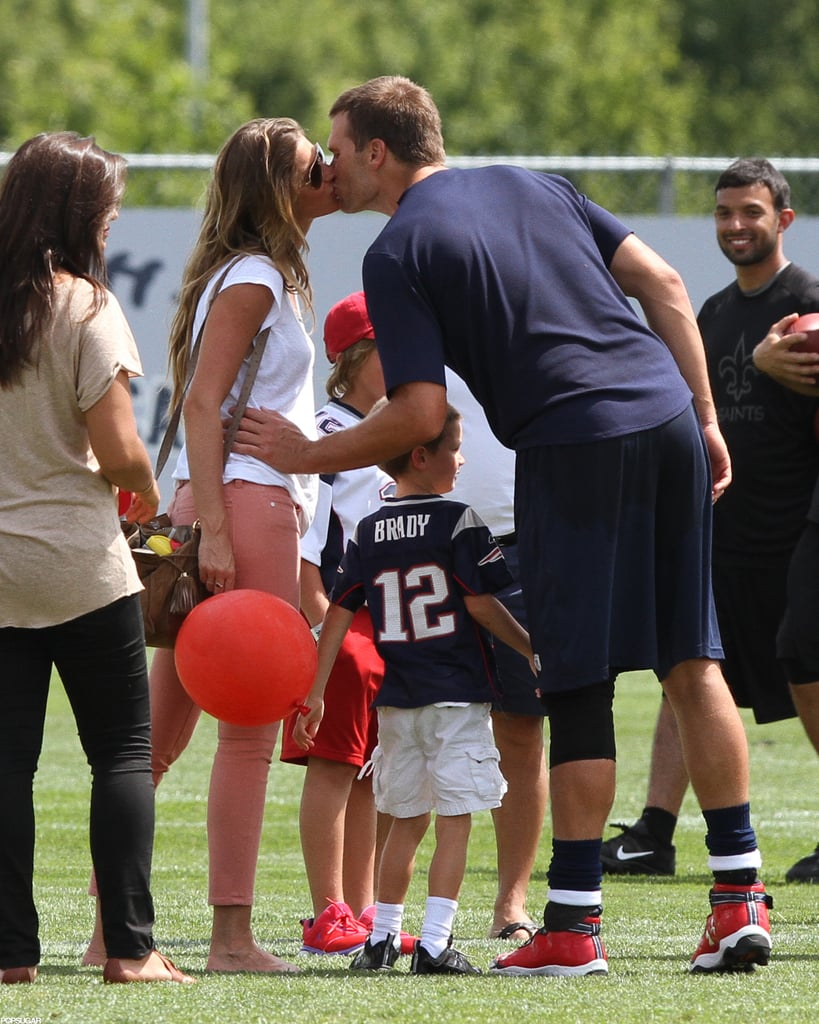 Tom Brady kissed Gisele Bündchen when she brought Benjamin Brady and Jack Moynahan to visit him at the Patriots practice game in Foxboro, MA, in August.