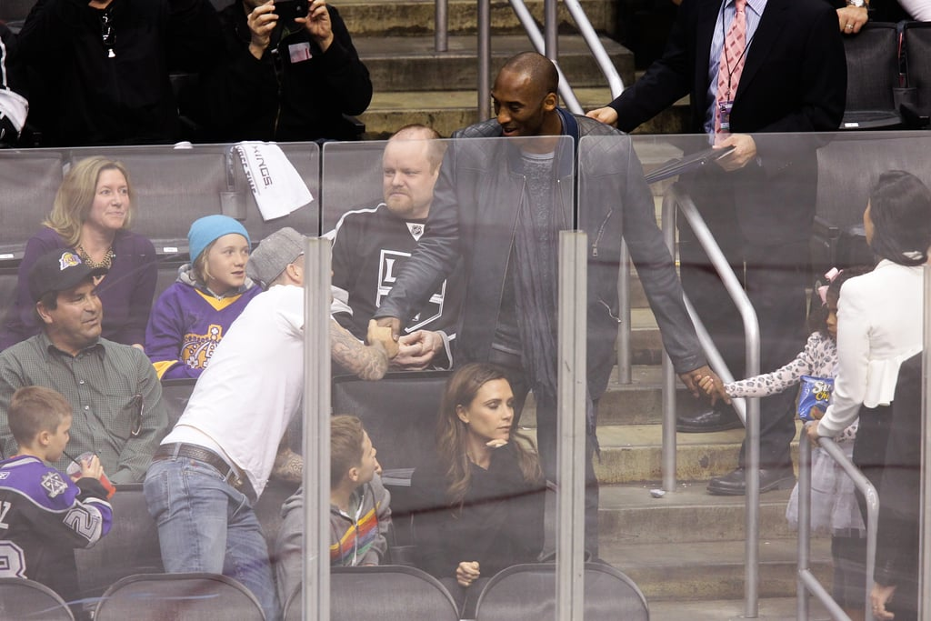 David Beckham greeted Kobe Bryant at the playoff hockey game in LA.