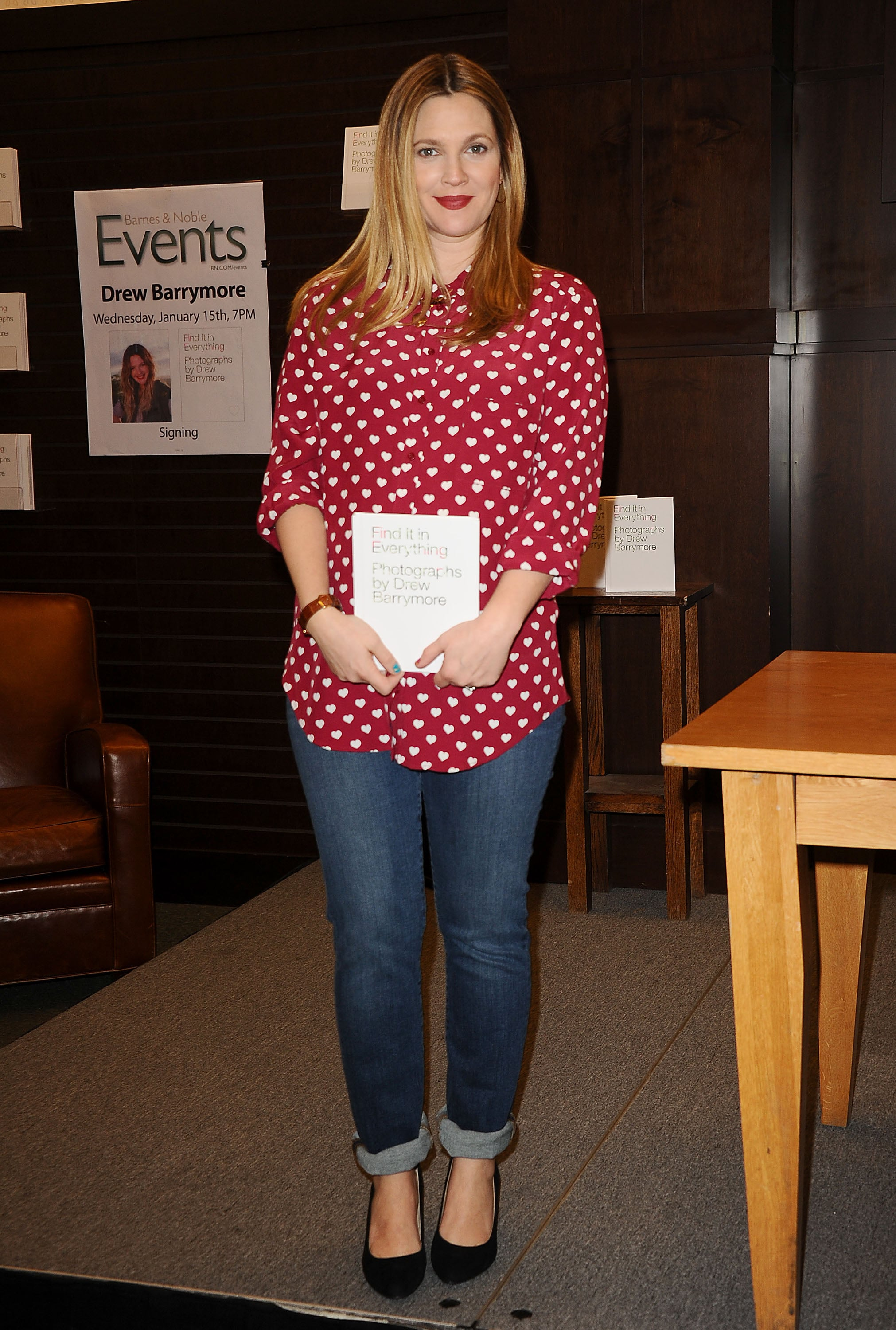 Drew Barrymore signed copies of her new book, Find It in Everything, working a heart-print Topshop blouse with cuffed denim. Where to Wear: A sleepover with your gals. Prank-calling: optional.