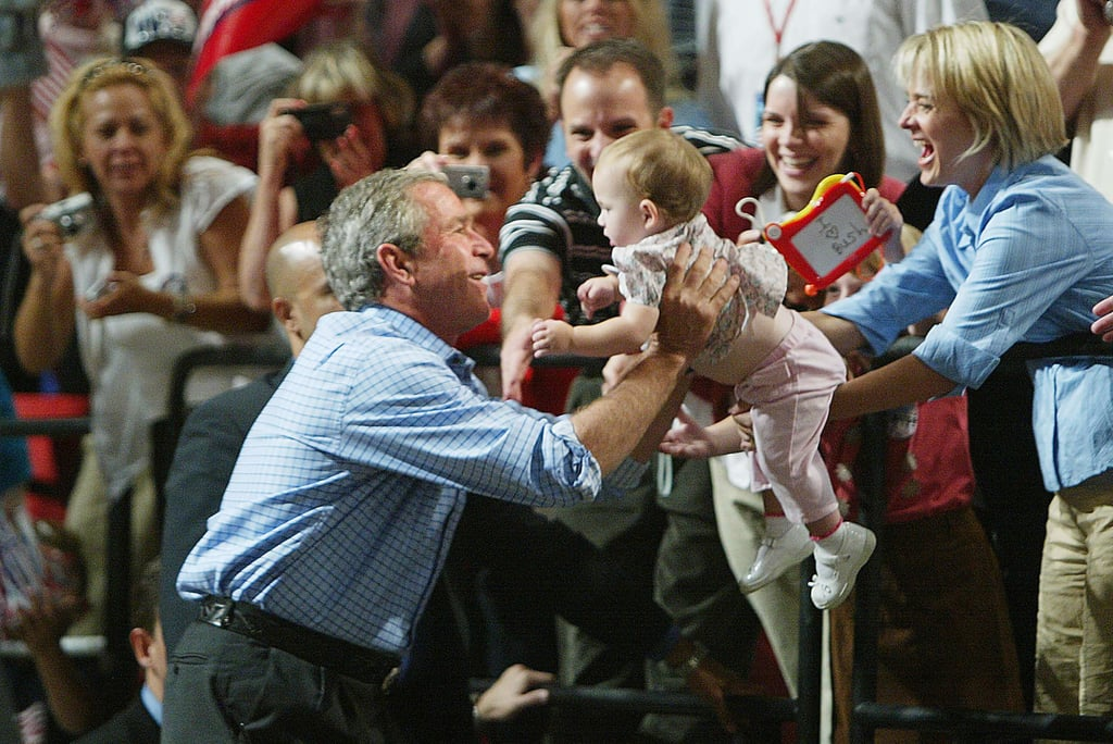 Some parents are eager to hand over their lil ones to the candidates, like this woman did with then-President George W. Bush during a Las Vegas campaign stop in 2004.