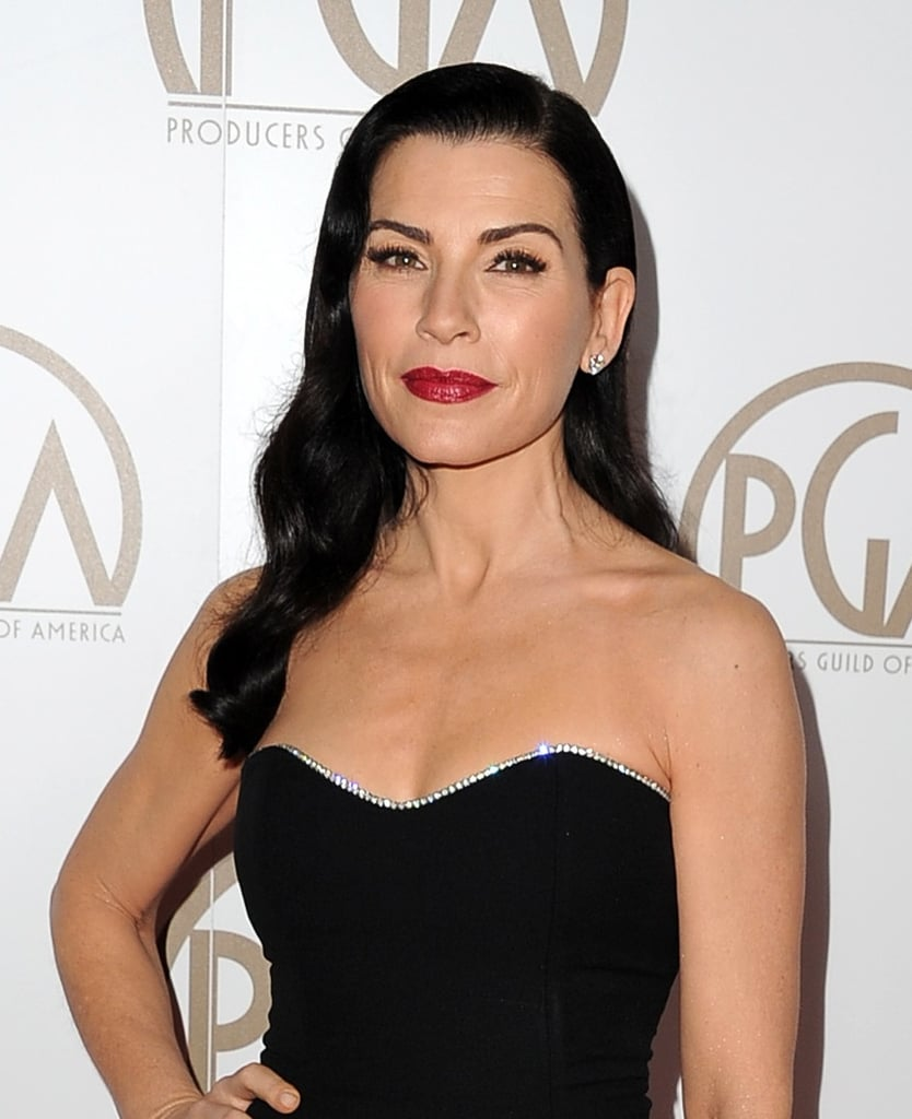 Julianna finished off her retro look with a sleek side part and bold red lips.