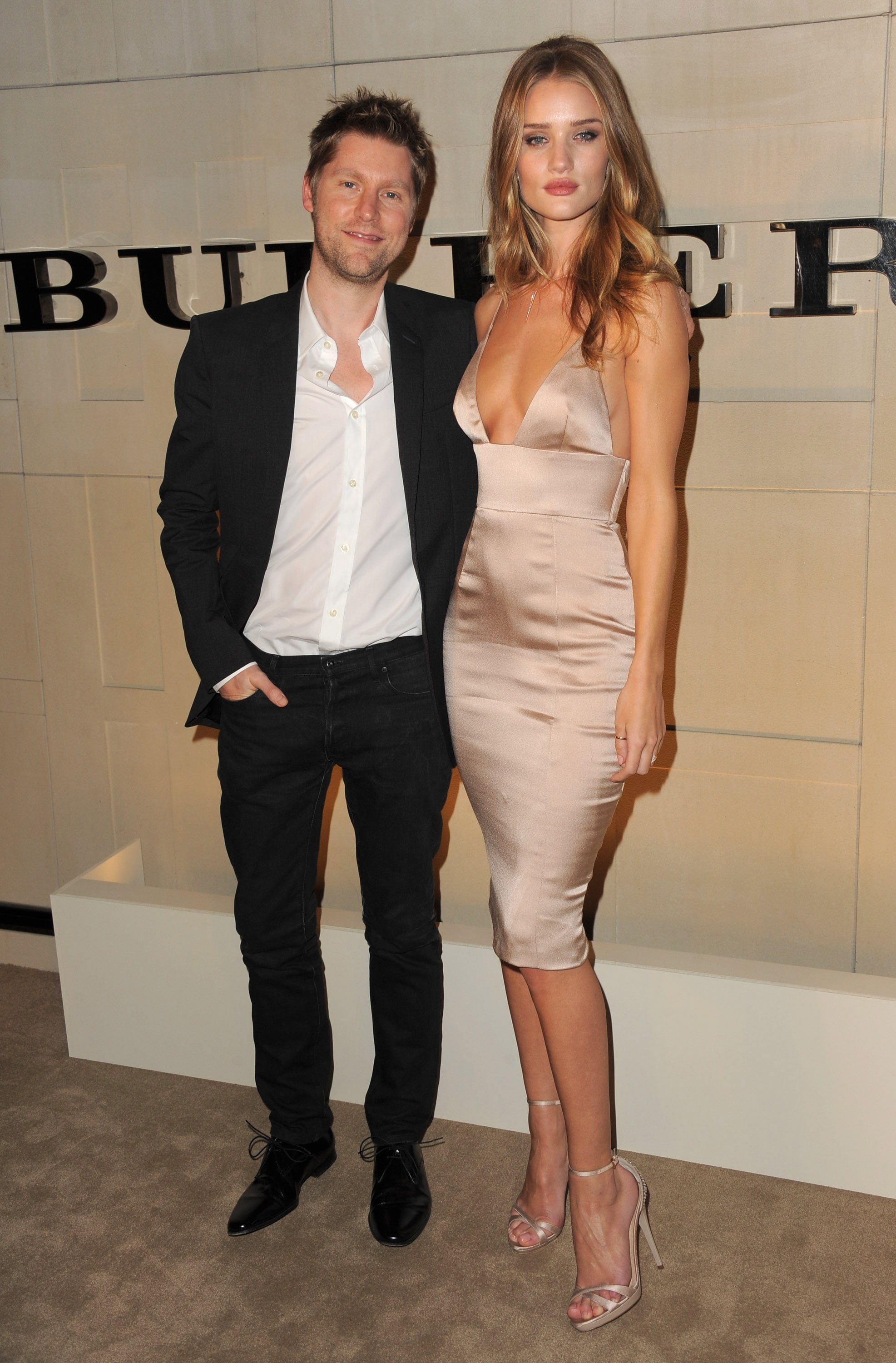 Burberry's Christopher Bailey with model Rosie Huntington-Whiteley.