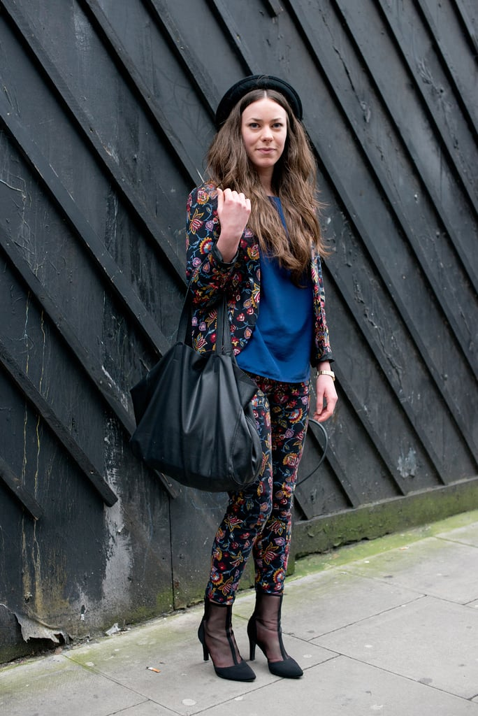 A bold paisley suit got a charming finish with a ladylike hat.
