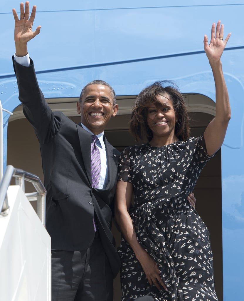 The Obamas waved to onlookers as they left Dar es Salaam, Tanzania, in July 2013.