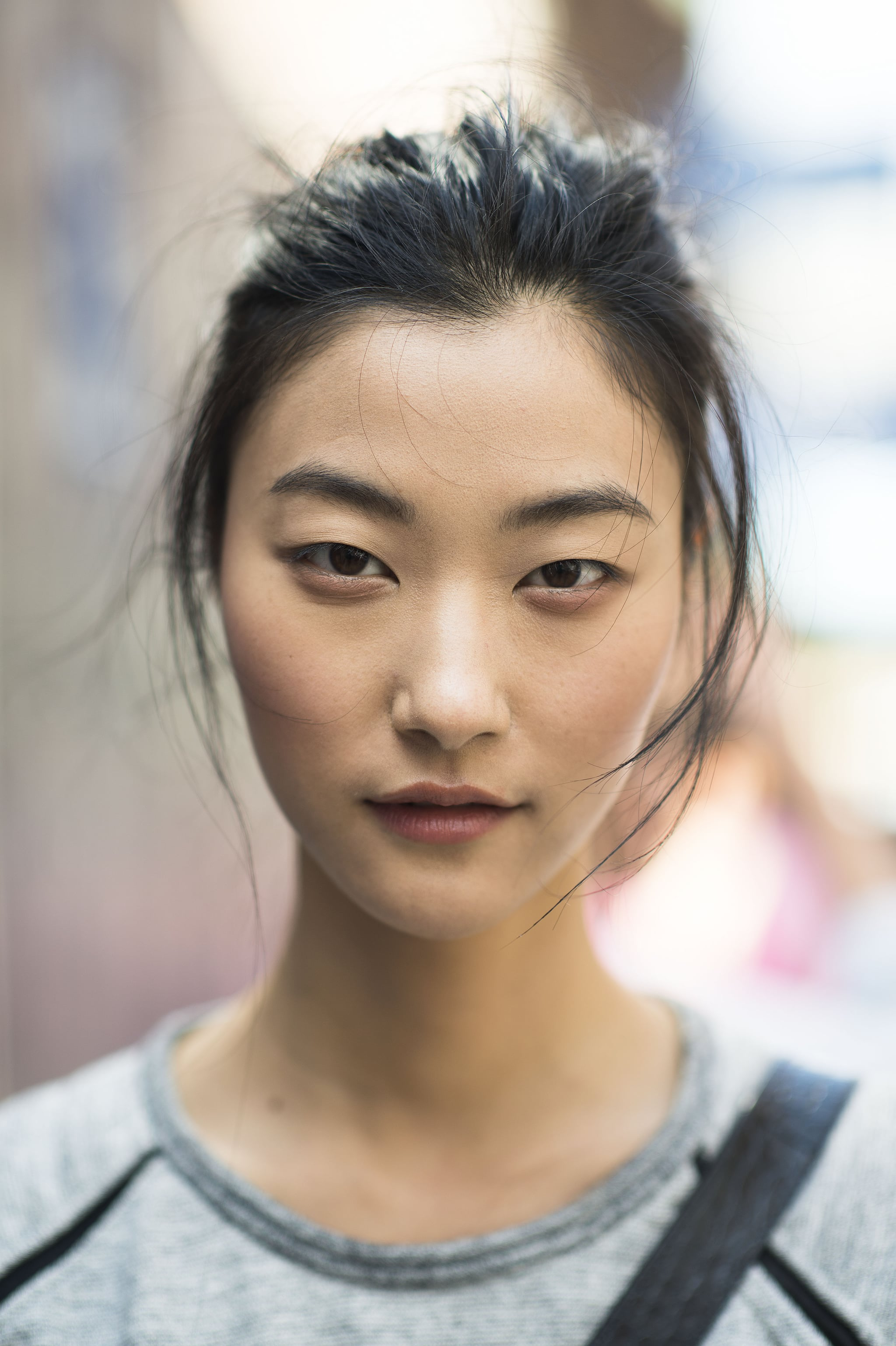We love the different shades of pink in this woman's look: a swipe of baby pink under the eyes, a touch of rose across the cheeks, and some deep rose on the lips.  Source: Le 21ème | Adam Katz Sinding