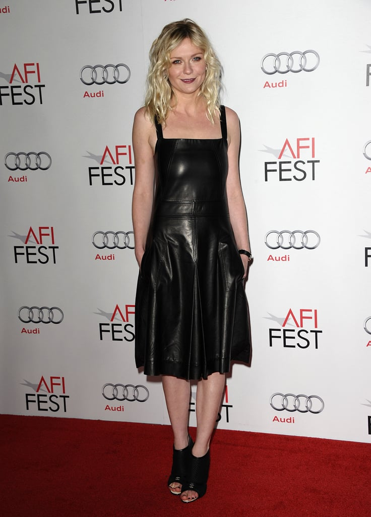 While attending a roundtable event at the AFI Fest in 2011, Kirsten opted for a darker look, wearing a black leather Derek Lam creation with black peep-toe booties.