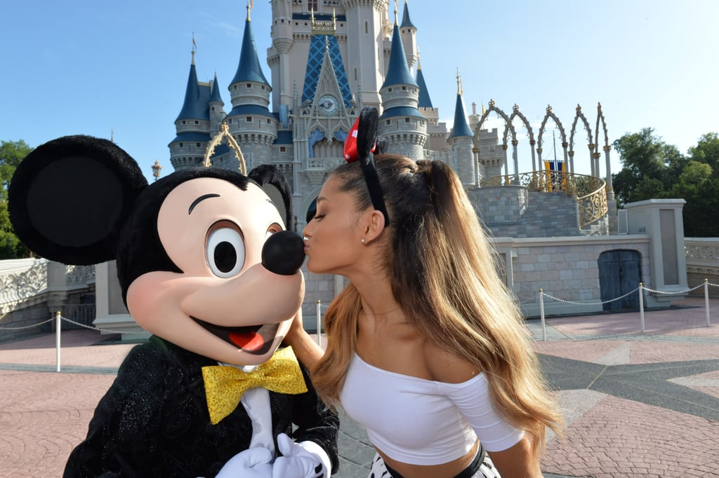 Ariana Grande celebrated her 21st birthday by kissing Mickey Mouse at Disney World on Tuesday.