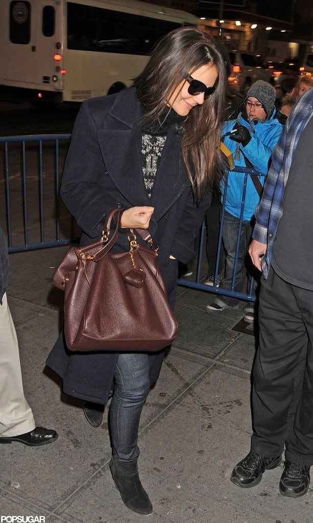 Katie Holmes smiled as she got out of her car and headed into her Broadway show.