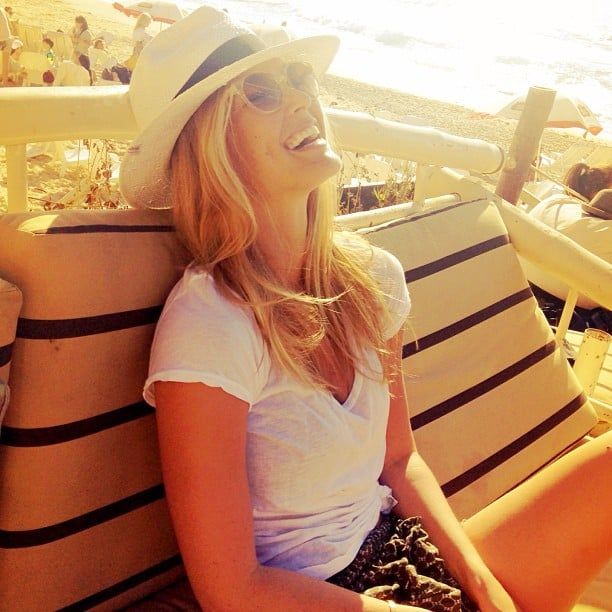 Bar Refaeli basked in the sun in style, wearing a straw Panama hat and sweet shades. Source: Instagram user barrefaeli