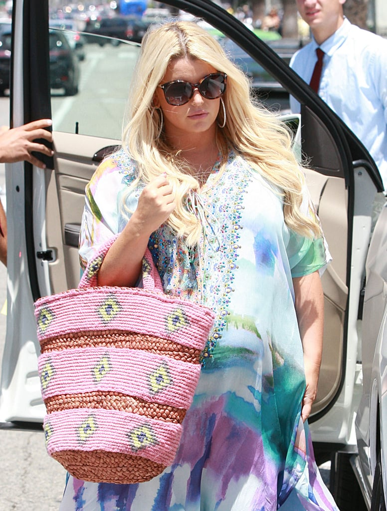 Jessica Simpson covered her baby bump with a flowing maxi dress for lunch with fiancé Eric Johnson.