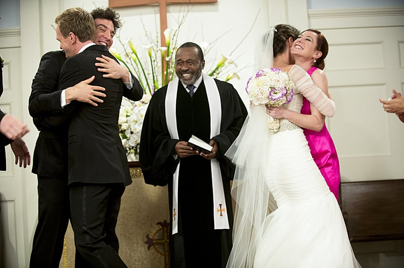 The bride and groom embrace their friends after the pronouncement.