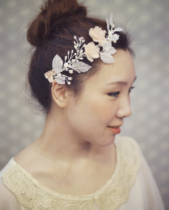 This blush pink floral headpiece ($173) has just the right amount of romantic flair.