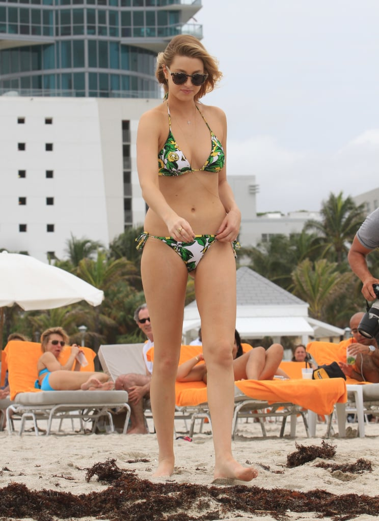 Whitney Port heads to the water at the beach.
