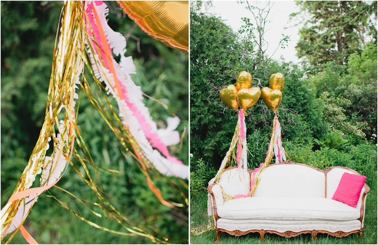A cool sofa from On Solid Ground Vintage Rentals combined with metallic heart balloons tied with fringed and gold streamers made for a lovely lounge area. Source: Canary Grey Photography for Somewhere Splendid