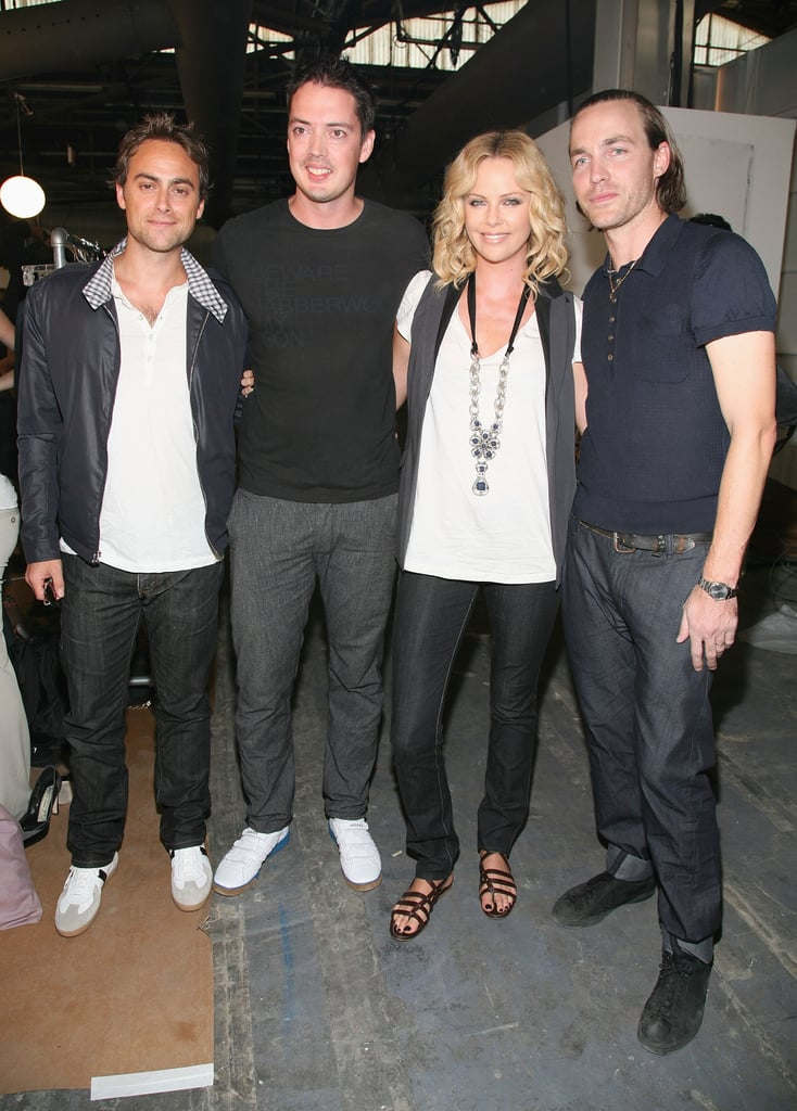 Stuart Townsend and Charlize Theron went backstage to pose with Rag & Bone designers Marcus Wainwright and David Neville in September 2008.