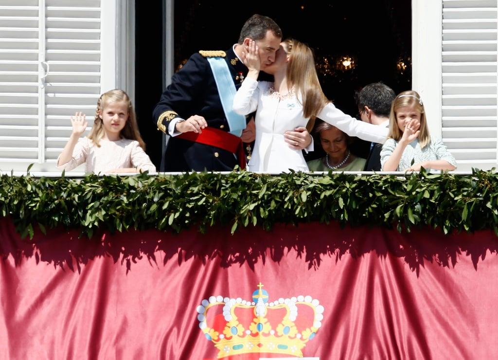 The newly crowned king and queen of Spain shared a kiss on the balcony of the royal palace in June 2014.