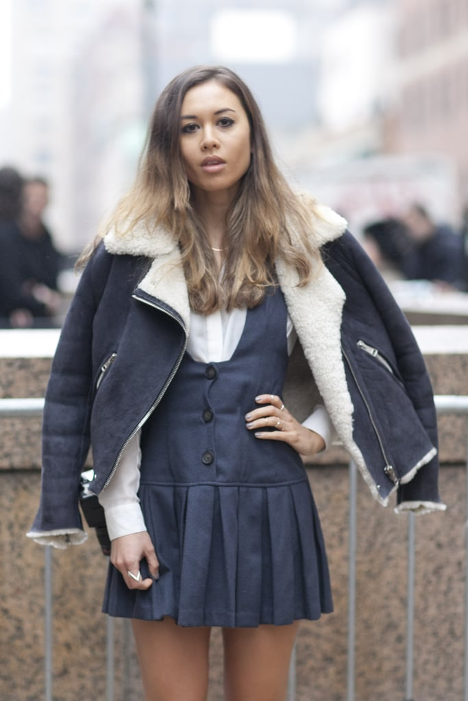 Rumi Neely topped her schoolgirl-inspired jumper with a cozy, shearling-lined jacket.