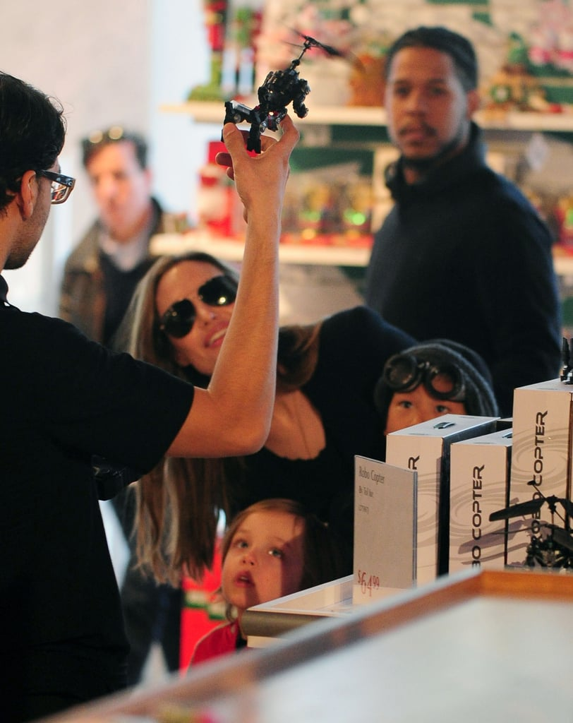 Angelina Jolie and her boys watched as a man demonstrated toys in NYC.