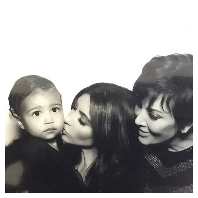 Kim gave North a kiss while Kris looked on during Kim and Kanye's 2014 wedding.